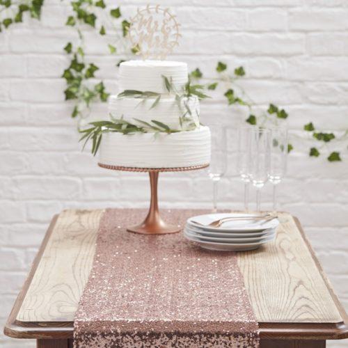 Tischläufer aus Pailletten-Stoff in roségold