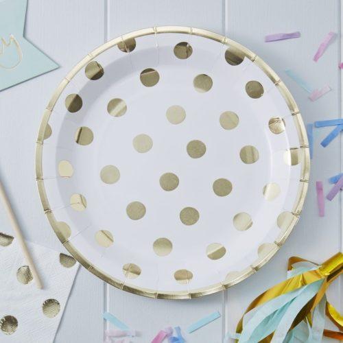 Pappteller mit goldenen Polka Dots
