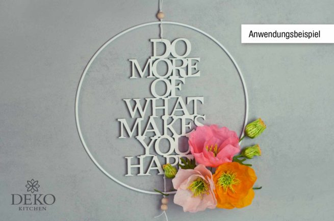 "Holzschrift ""Do more of what makes you happy"""